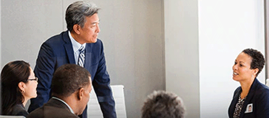 man talking to woman during presentation at work